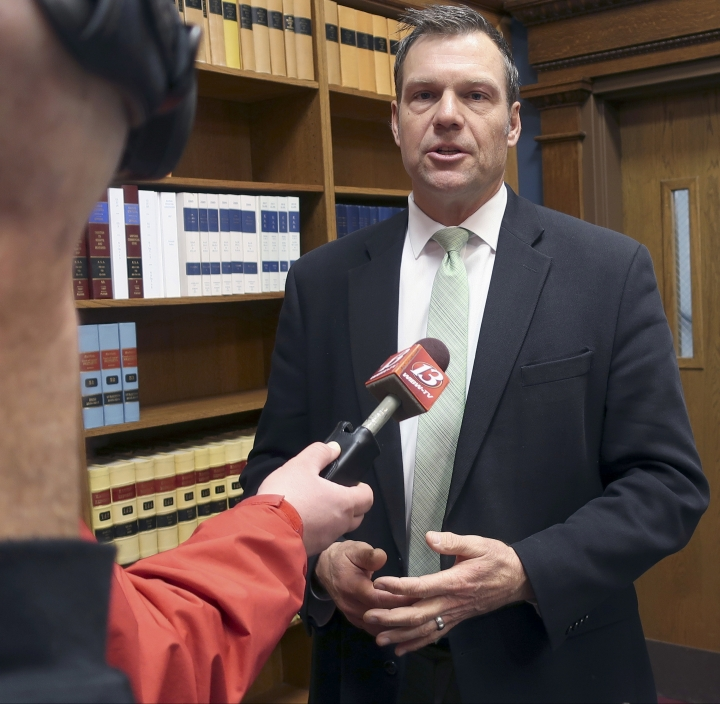 FILE - In this Nov. 30, 2018 file photo, then Kansas Secretary of State Kris Kobach responds to questions from reporters in Topeka, Kan. An appeals court in Salt Lake City, will consider Monday, March 18, 2019, the constitutionality of a struck down Kansas statute that had required people to provide documents proving U.S. citizenship before they could register to vote. (AP Photo/John Hanna, File)