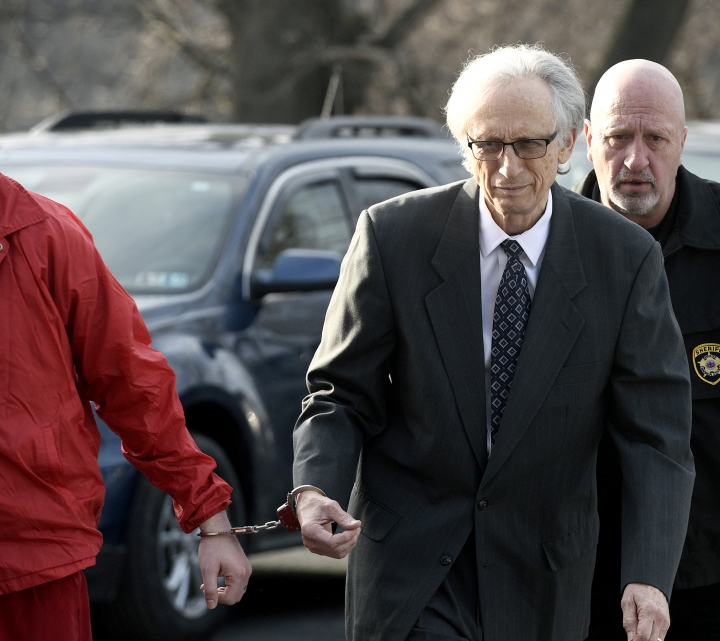 Dr. Johnnie Barto heads into Cambria County Courthouse, in Ebensburg, Pa., on Monday, March 18, 2019, for his sentencing in the sexual assault of over two dozen children. (Todd Berkey/The Tribune-Democrat via AP)