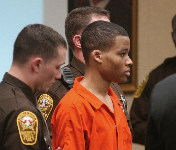 FILE - In this Oct. 20, 2003 file photo, Lee Boyd Malvo listens to court proceedings during the trial of fellow sniper suspect John Allen Muhammad in Virginia Beach, Va. The Supreme Court has agreed to consider Virginia's plea to reinstate the life without parole sentence of a man who participated in sniper shootings that terrorized the Washington, D.C., region in 2002. The justices said Monday they will take up the state's appeal in the case of Lee Boyd Malvo. Malvo was 17 when he and John Allen Muhammad fatally shot 10 people in Maryland, Virginia and Washington. Malvo was sentenced to life-without-parole terms in both Virginia and in Maryland. (AP Photo/Martin Smith-Rodden, Pool, File)
