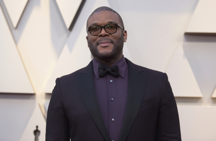 FILE - In this Feb. 24, 2019 file photo, Tyler Perry arrives at the Oscars at the Dolby Theatre in Los Angeles. Less than a day after the family of a slain single mother of four launched a fundraising appeal, Perry has lent his support. News outlets report Perry offered to take care of the family's rent to stave off eviction, arrange for 45-year-old Tynesha Evans' body to be flown to Wisconsin for burial and cover her 18-year-old daughter's tuition at Spelman College so she doesn't have to drop out.(Photo by Richard Shotwell/Invision/AP, File)