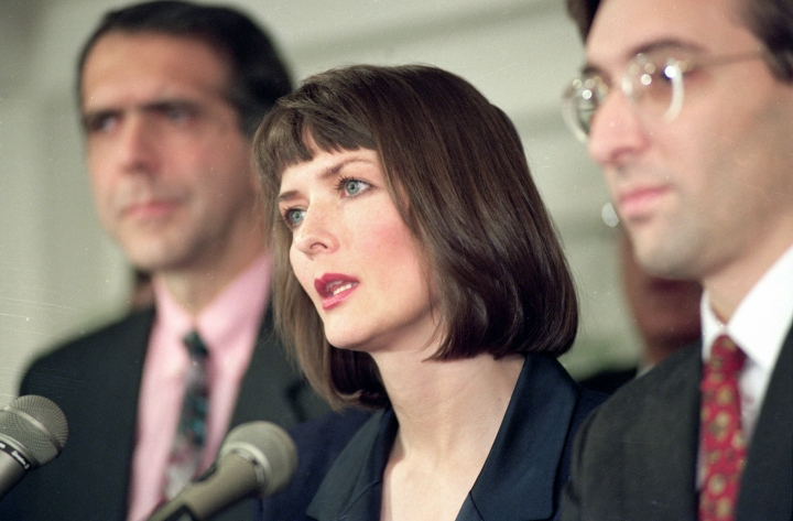 """FILE - In this Dec. 10, 1992 file photo, flanked by her attorneys Frank Morocco, left, and Sheldon T. Zenner, right, Lawrencia Bembenek answers questions at a new conference in Chicago, Ill. The attorney for Wisconsin's famous runaway convict and convicted murderer Laurie """"Bambi"""" Bembenek is asking Gov. Tony Evers for a pardon. Bembenek insisted up until her death in 2010 that she did not kill the ex-wife of her husband in 1982. Her attorney filed a pardon request with Evers earlier this year. Bembenek, a former Milwaukee Police officer who escaped from prison after she was convicted of murder in a wild criminal saga that later became a TV miniseries. (AP Photo/Mark Elias, File)"""