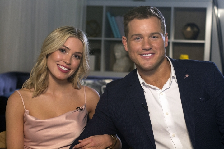 """Cast members Cassie Randolph, left, and Colton Underwood from the reality series, """"The Bachelor,"""" appear during an interview in New York on Wednesday, March 13, 2019. (AP Photo/Gary Gerard Hamilton)"""