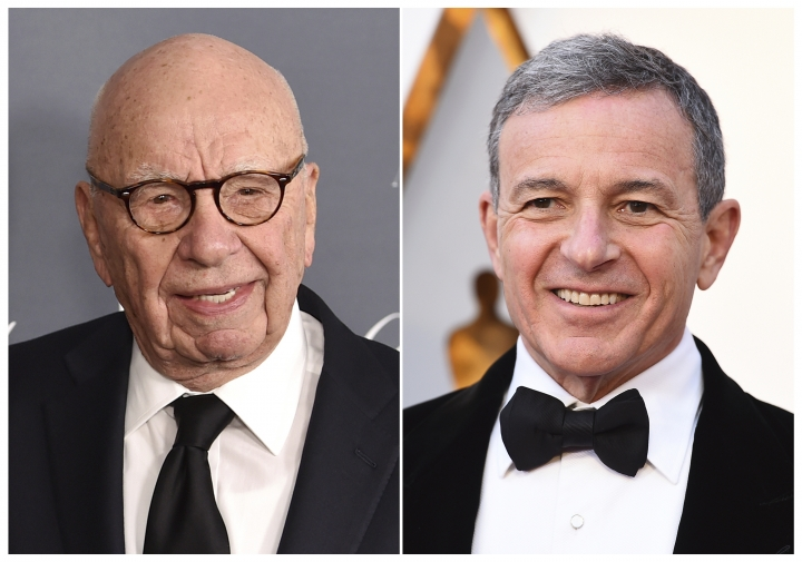 This combination photo shows Fox News chairman and CEO Rupert Murdoch at the WSJ Magazine 2017 Innovator Awards in New York on Nov. 1, 2017, left, and Disney CEO Bob Iger at the Oscars in Los Angeles on March 4, 2018. Disney's $71.3 billion acquisition of Fox's entertainment assets is set to close around 12 a.m. EDT on Wednesday. (AP Photo)