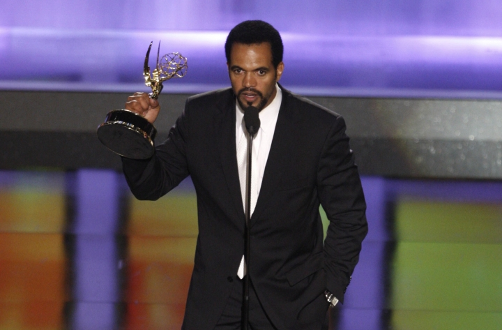 "FILE - In this June 20, 2008, file photo Kristoff St. John accepts the award for outstanding supporting actor in a drama series for his work on ""The Young and the Restless"" at the 35th Annual Daytime Emmy Awards in Los Angeles. Officials say St. John died of heart disease, with heavy drinking at the time of his death as a contributing factor. A coroner's report released Tuesday lists ""hypertrophic heart disease"" as the cause of the 52-year-old's death on Feb. 4 at his home in Los Angeles. ""Hypertrophic"" means the heart muscle has become abnormally thick. (AP Photo/Matt Sayles, File)"