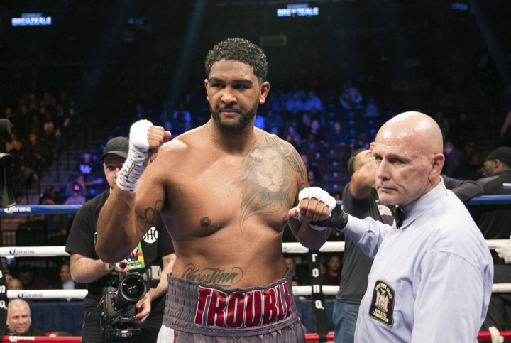 FILE - In this Nov. 4, 2017, file photo, Dominic Breazeale celebrates after defeating Eric Molina in a heavyweight boxing match in New York. Wilder is slated to defend his title May 18, 2019, at Barclays Center in New York, against mandatory challenger Dominic Breazeale. (AP Photo/Kevin Hagen, File)