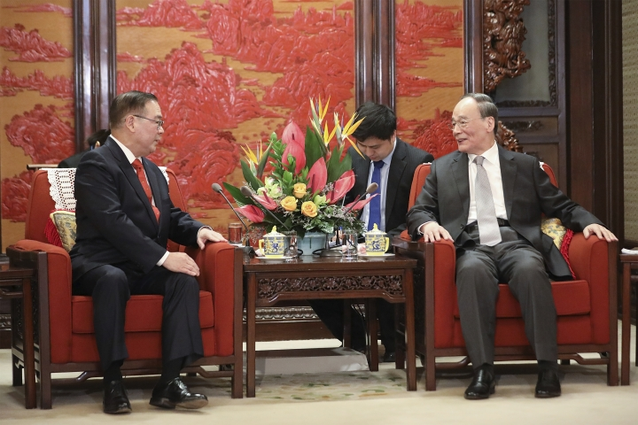 Chinese Vice President Wang Qishan, right, meets Philippines Secretary of Foreign Affairs Teodoro Locsin at Zhongnanhai on March 19, 2019, in Beijing, China. (Andrea Verdelli/Pool Photo via AP)