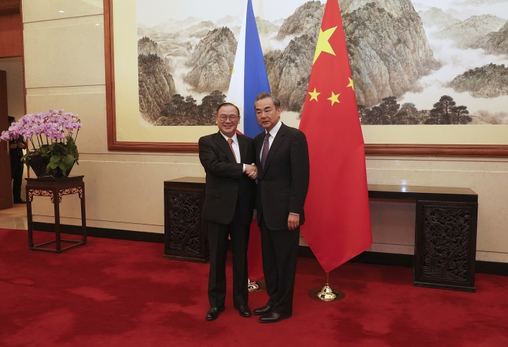 Chinese Foreign Minister Wang Yi, right, shakes hands with Filipino Secretary of Foreign Affairs Teodoro Locsin Jr. at Diaoyutai State Guesthouse Wednesday, March 20, 2019 in Beijing, China. (Andrea Verdelli/Pool Photo via AP)