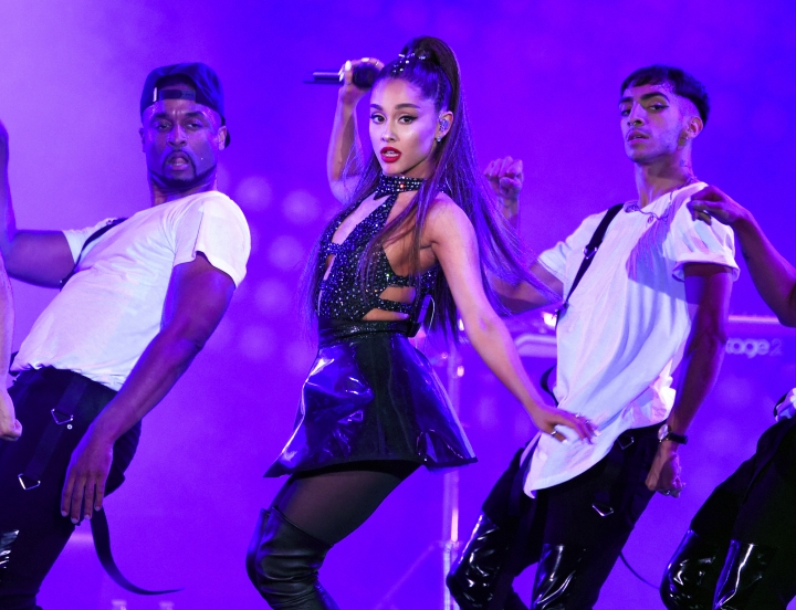 FILE - In this June 2, 2018 file photo, Ariana Grande, center, performs at Wango Tango in Los Angeles. Grande, Childish Gambino, Twenty One Pilots and The Strokes will headline this summer's Lollapalooza music festival in Chicago. Kacey Musgraves, Janelle Monae and Lil Wayne also are scheduled to be at the four-day event Aug. 1-4. (Photo by Chris Pizzello/Invision/AP, File)