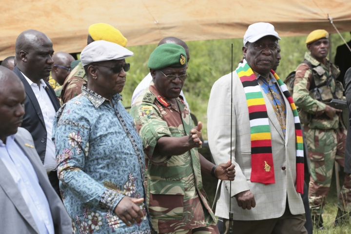 Zimbabwean President Emmerson Mnangagwa, right, visits Chimanimani, about 600km south east of Harare, Zimbabwe, Wednesday March 20, 2019. Mnangagwa visited a part of Chimanimnani affected by cyclone Idai and promised assitance in the form of food and rebuilding of homes. Hundreds are dead, many more missing and thousands at risk from massive flooding in Mozambique, Malawi and Zimbabwe caused by Cyclone Idai. (AP Photo/Tsvangirayi Mukwazhi)