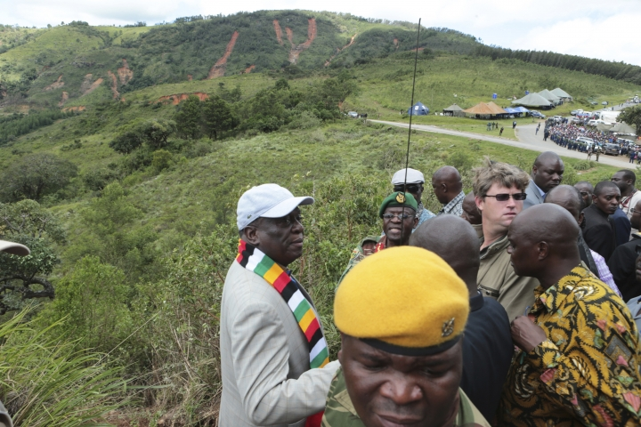 Zimbabwean President Emmerson Mnangagwa, left, visits Chimanimani, about 600km south east of Harare, Zimbabwe, Wednesday, March, 20, 2019. Mnangagwa visited a part of Chimanimnani affected by cyclone Idai and promised assitance in the form of food and rebuilding of homes. Hundreds are dead, many more missing and thousands at risk from massive flooding in Mozambique, Malawi and Zimbabwe caused by Cyclone Idai. (AP Photo/Tsvangirayi Mukwazhi)