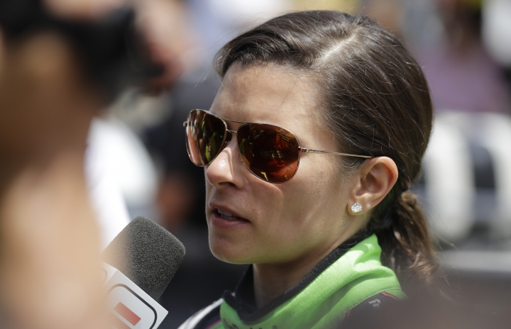 """FILE - In this May 27, 2018 file photo, Danica Patrick is interviewed following her release from the infield hospital after being checked following a crash in the Indianapolis 500 auto race at Indianapolis Motor Speedway in Indianapolis. NBC Sports announced Wednesday, March 20, 2019, that Patrick will be part of its inaugural broadcast of the Indianapolis 500, a project that will return Patrick to the famed Indianapolis Motor Speedway for the first time since she ended her career there last May with the second leg of the """"Danica Double."""" (AP Photo/Darron Cummings)"""