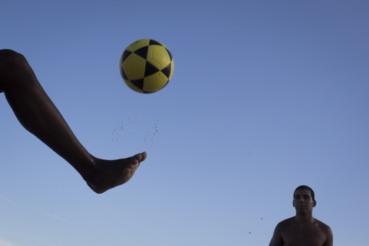 """FILE - In this May 31, 2014 file photo, a player controls a ball during a game of """"altinho,"""" where the goal is to keep the ball airborne while passed amid players, on Ipanema beach in Rio de Janeiro, Brazil. The joint candidacy for the 2030 World Cup soccer tournament, presented by Argentina, Chile, Paraguay and Uruguay, was announced on Wednesday, March 20, 2019 in Buenos Aires during a meeting of those South American nations' leaders. (AP Photo/Felipe Dana, File)"""