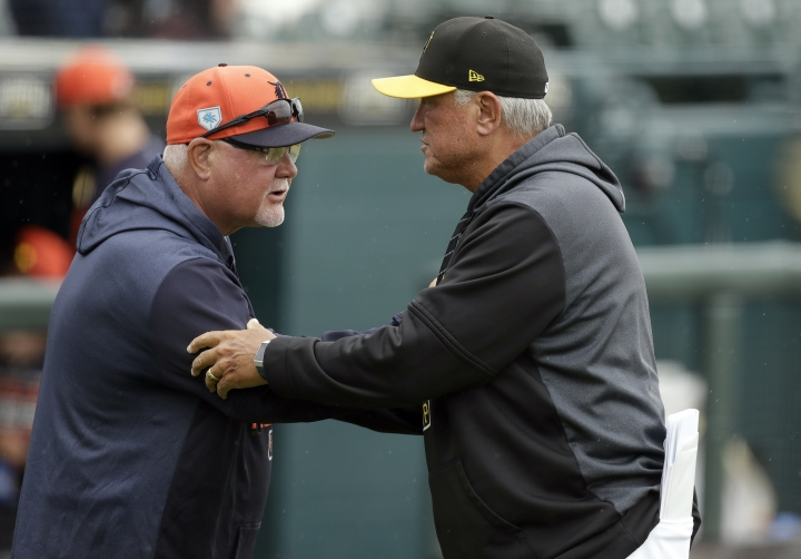 Pittsburgh Pirates manager Clint Hurdle, right, meets Detroit Tigers manager Ron Gardenhire before a spring training baseball game Tuesday, March 19, 2019, in Bradenton, Fla. (AP Photo/Chris O'Meara)