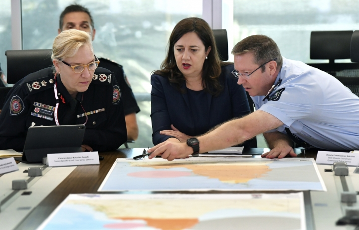 In this March 19, 2019, photo, Queensland Fire and Emergency Services Commissioner, Katarina Carroll (left), Queensland Premier Annastacia Palaszczuk (center) and Queensland Police Deputy Commissioner Bob Gee (right) are seen during a meeting of the Queensland Disaster Management Committee discussing the approaching cyclone at the Emergency Services Complex in Brisbane. Australia is evacuating about 2,000 people from part of northern Australia ahead of powerful Cyclone Trevor expected to hit on Saturday. (Darren England/AAP Image via AP)