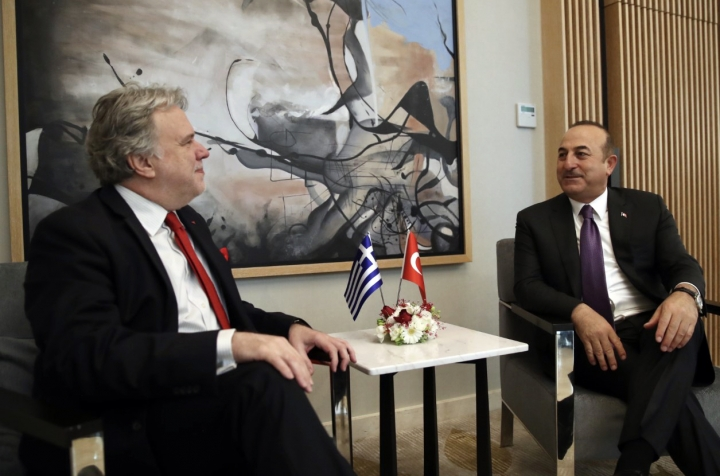 Turkey's Foreign Minister Mevlut Cavusoglu, right, and his Greek counterpart Giorgos Katrougalos speak in the Mediterranean coastal city of Antalya, Turkey, Thursday, March 21, 2019. Cavusogly says the defense chiefs of Turkey and Greece could meet soon as part of new confidence-building measures aimed at reducing tensions between the NATO allies. (Turkish Foreign Ministry via AP, Pool)