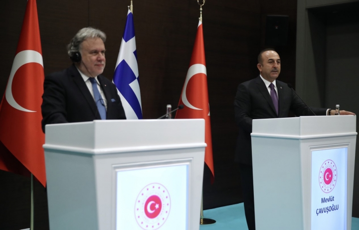Turkey's Foreign Minister Mevlut Cavusoglu, right, and his Greek counterpart Giorgos Katrougalos speak to the media after their talks in the Mediterranean coastal city of Antalya, Turkey, Thursday, March 21, 2019. Cavusogly says the defense chiefs of Turkey and Greece could meet soon as part of new confidence-building measures aimed at reducing tensions between the NATO allies. (Turkish Foreign Ministry via AP, Pool)