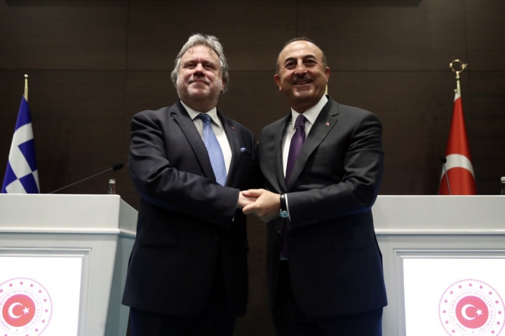 Turkey's Foreign Minister Mevlut Cavusoglu, right, and his Greek counterpart Giorgos Katrougalos pose for photos after a news conference in the Mediterranean coastal city of Antalya, Turkey, Thursday, March 21, 2019. Cavusogly says the defense chiefs of Turkey and Greece could meet soon as part of new confidence-building measures aimed at reducing tensions between the NATO allies. (Turkish Foreign Ministry via AP, Pool)