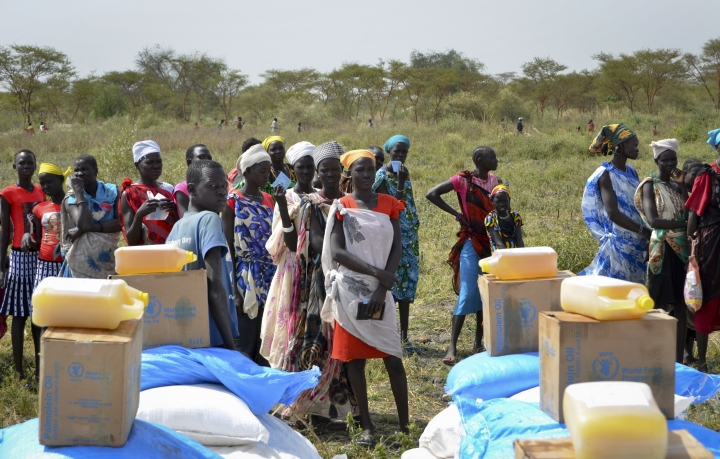 FILE - In this Saturday, Dec. 9, 2017 file photo, people wait in line for food rations at a World Food Program distribution in Jiech, Ayod County, South Sudan. South Sudan's committee overseeing the fragile transition from civil war has approved almost $185 million in spending on vehicles, food and home renovations while the country's peace deal suffers from an alleged lack of funds, according to internal documents seen by The Associated Press. (AP Photo/Sam Mednick, File)