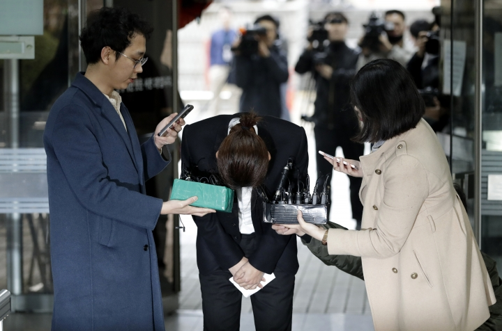 K-pop singer Jung Joon-young bows upon his arrival to attend a hearing at the Seoul Central District Court in Seoul, South Korea, Thursday, March 21, 2019. A South Korean pop star has appeared at a court hearing to decide whether to arrest him over allegations that he illegally shared sexually explicit videos of women taken without their knowledge or consent in online group chats.(AP Photo/Lee Jin-man)