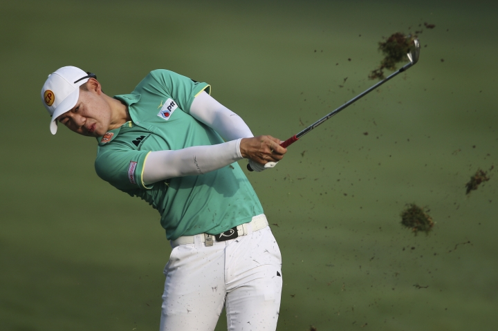 Jazz Janewattananond of Thailand plays his shot on the 10th hole during the Malaysia Golf Championship Round One in Kuala Lumpur, Malaysia, Thursday, March 21, 2019. (AP Photo/Vincent Phoon)