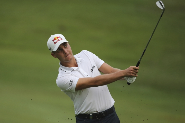 Matthias Schwab of Austria plays his shot at the 10th hole at the Malaysia Golf Championship Round One in Kuala Lumpur, Malaysia, Thursday, March 21, 2019. (AP Photo/Vincent Phoon)