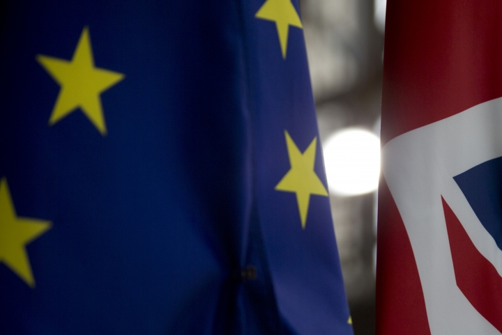 Light shines between the EU flag, left, and the Union Flag, right, prior to an EU summit at the Europa building in Brussels, Wednesday, March 20, 2019. European Union officials received a letter from British Prime Minister Theresa May requesting a Brexit extension and they hope to have more clarity about her intentions by Thursday. (AP Photo/Virginia Mayo)