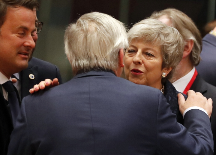 British Prime Minister Theresa May, right, speaks with European Commission President Jean-Claude Juncker during a round table meeting at an EU summit in Brussels, Thursday, March 21, 2019. British Prime Minister Theresa May is trying to persuade European Union leaders to delay Brexit by up to three months, just eight days before Britain is scheduled to leave the bloc. (AP Photo/Frank Augstein)