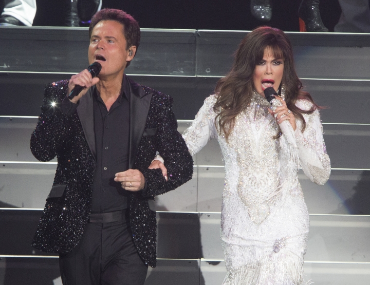 "FILE - This Aug. 22, 2017 file photo shows Donny Osmond, left, and Marie Osmond performing at the Santander Arena in Reading, Pa. Donny and Marie Osmond say they will end their Las Vegas show later this year, concluding an 11-year run on the Strip. The brother-sister duo made the announcement during an appearance on ""Good Morning America"" on Thursday, March 21, 2019. Their final performance at the Flamingo Las Vegas is scheduled for Nov. 16. (Photo by Owen Sweeney/Invision/AP, File)"