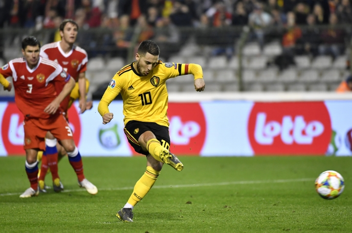 Belgium's Eden Hazard shoots a penalty kick to score his sides second goal during the Euro 2020 Group I qualifying match between Belgium and Russia at the King Baudouin stadium in Brussels on Thursday March 21, 2019. (AP Photo/Geert Vanden Wijngaert)