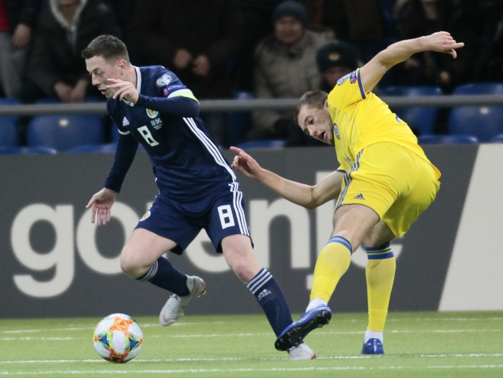 Scotland's Callum McGregor, left, and Kazakhstan's Roman Murtazayev challenge for the ball during the Euro 2020 group I qualifying soccer match between Kazakhstan and the Scotland at Astana Arena stadium in Astana, Kazakhstan, Thursday, March 21, 2019. (AP Photo/Alexei Filippov)