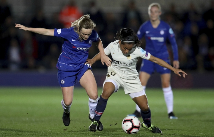 Chelsea Women's Erin Cuthbert, left, in action with Paris Saint-Germain Women's Perle Morroni during their Women's Champions League quarter final first leg match at the Cherry Red Records Stadium in London, Thursday March 21, 2019. (Bradley Collyer/PA via AP)