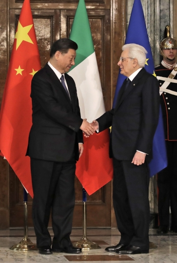 "Chinese President Xi Jinping, left, shakes hands with Italian President Sergio Mattarella at the Quirinale Presidential Palace, in Rome, Friday, March 22, 2019. Jinping is launching a two-day official visit aimed at deepening economic and cultural ties with Italy through an ambitious infrastructure building program called ""Belt and Road"" that has raised suspicions among Italy's U.S. and European allies. (AP Photo/Alessandra Tarantino, Pool)"