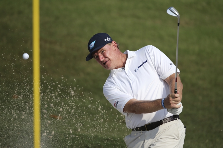 Ernie Els of South Africa play his shot from the bunker on the 17th hole at the Malaysia Golf Championship 2nd round in Kuala Lumpur, Malaysia, Friday, March 22, 2019. (AP Photo/Vincent Phoon)