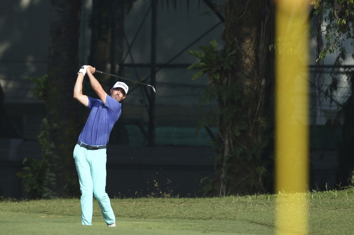 Paul Peterson of the United States plays follows his swing on the 2nd hole at the Malaysia Golf Championship Round 2 in Kuala Lumpur, Malaysia, Friday, March 22, 2019. (AP Photo/Vincent Phoon)