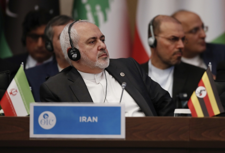 Iran's Foreign Minister Mohammad Javad Zarif listens during an emergency session of 57-member Organization of Islamic Cooperation's executive committee meeting, in Istanbul, Friday, March 22, 2019. An emergency meeting of the organization of Islamic Conference was held in Istanbul in Turkey after a gunman killed 50 people in two mosques in New Zealand.(AP Photo/Emrah Gurel)