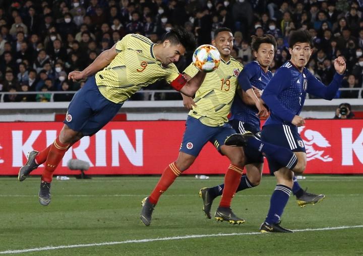 Colombia's Radamel Falcao, left, tries to score a goal during a friendly soccer match between Japan and Colombia in Yokohama, Japan, Friday, March 22, 2019. (AP Photo/Shuji Kajiyama)