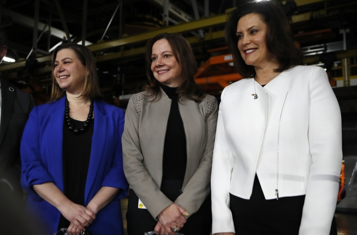 General Motors Chairman and CEO Mary Barra, center, stands with U.S. Rep. Elissa Slotkin, left, and Michigan Gov. Gretchen Whitmer after announcing an investment of $300 million in its Orion Township, Mich., assembly plant to produce a new Chevrolet electric vehicle, Friday, March 22, 2019, in Orion Township, Mich. (AP Photo/Carlos Osorio)