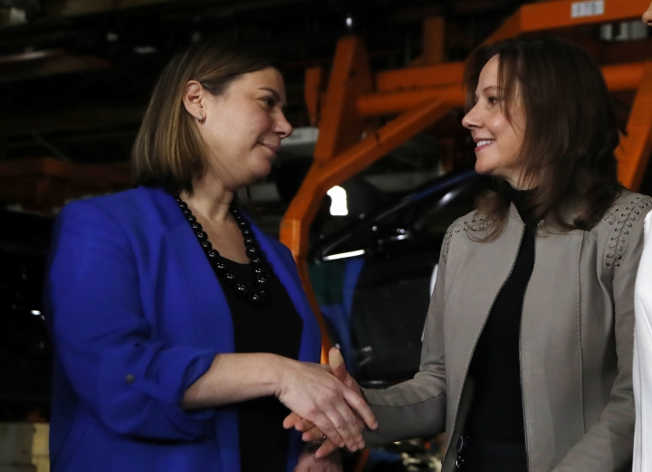 General Motors Chairman and CEO Mary Barra, right, shakes hands with with U.S. Rep. Elissa Slotkin after announcing an investment of $300 million in its Orion Township, Mich., assembly plant to produce a new Chevrolet electric vehicle, Friday, March 22, 2019, in Orion Township, Mich. (AP Photo/Carlos Osorio)