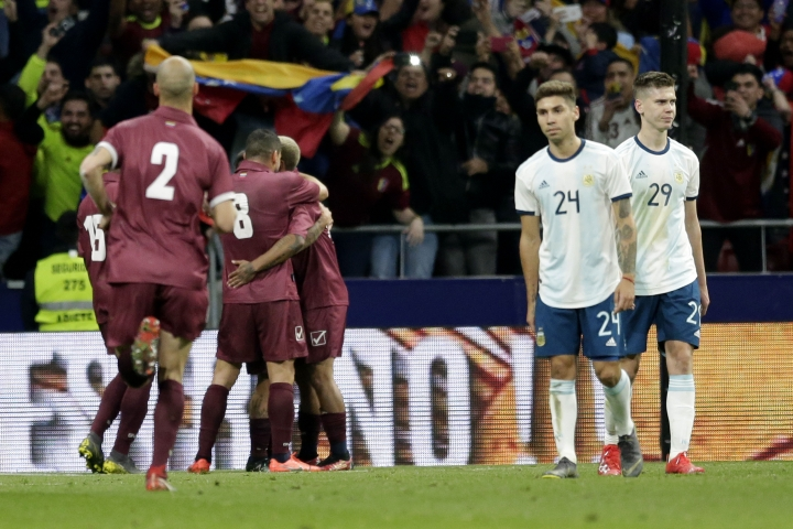 Venezuela's players, left, celebrated the third goal against Argentina during an international friendly soccer match between Argentina and Venezuela at Wanda Metropolitano stadium in Madrid, Spain, Friday, March 22, 2019. (AP Photo/Bernat Armangue)