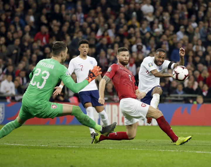 England's Raheem Sterling, right, scores his side's third goal during the Euro 2020 group A qualifying soccer match between England and the Czech Republic at Wembley stadium in London, Friday March 22, 2019. (AP Photo/Tim Ireland)