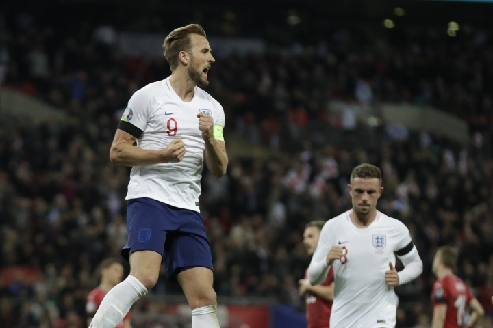 England's Harry Kane celebrates his sides second goal during the Euro 2020 group a qualifying soccer match between England and the Czech Republic at Wembley stadium in London, Friday March 22, 2019. (AP Photo/Matt Dunham)