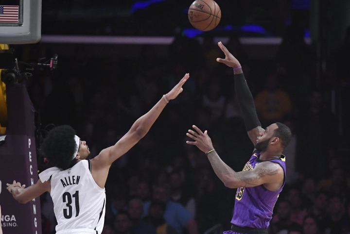 Los Angeles Lakers forward LeBron James, right, shoots as Brooklyn Nets center Jarrett Allen defends during the first half of an NBA basketball game Friday, March 22, 2019, in Los Angeles. (AP Photo/Mark J. Terrill)