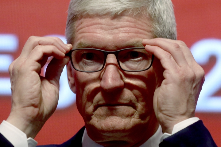 "Apple CEO Tim Cook attends the Economic Summit held for the China Development Forum in Beijing, China, Saturday, March 23, 2019. Cook says he's ""extremely bullish"" about the global economy based on the amount of innovation being carried out, and he's urging China to continue to ""open up."" (AP Photo/Ng Han Guan)"