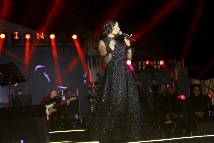In this Dec. 31, 2018 photo, Egyptian singer Sherine Abdel-Wahab performs during New Years' Eve, in Cairo, Egypt. Abdel-Wahab has been banned from performing in her home country after suggesting that it does not respect free speech. (AP Photo/Mahmoud Abdel Nasser)