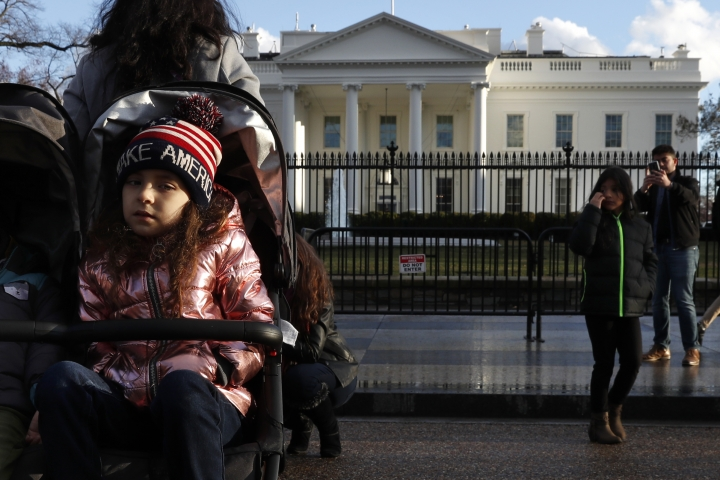 Tourists visit the White House with her family, Friday March 22, 2019, in Washington, as news breaks that special counsel Robert Mueller has concluded his investigation into Russian election interference and possible coordination with associates of President Donald Trump. The Justice Department says Mueller delivered his final report to Attorney General William Barr, who is reviewing it. Mueller's report, still confidential, sets the stage for big public fights to come. The next steps are up to Trump's attorney general, to Congress and, in all likelihood, federal courts. (AP Photo/Jacquelyn Martin)
