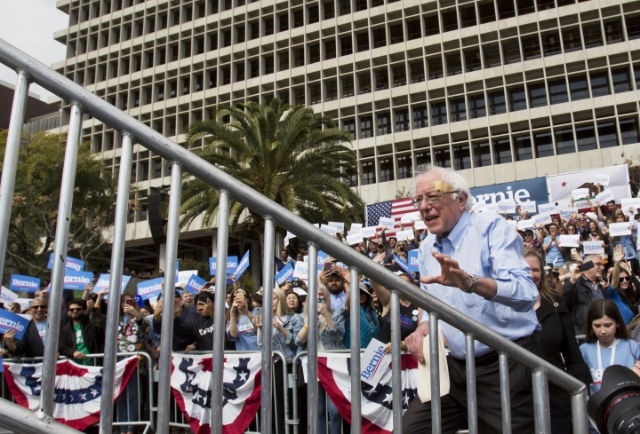 Democratic presidential candidate Sen. Bernie Sanders climbs to the podium as he arrives at a rally at Grand Park in Los Angeles Saturday, March 23, 2019. The Vermont senator made a notable, second-place finish in California's 2016 presidential primary when he won 27 of 58 counties. (AP Photo/Damian Dovarganes)