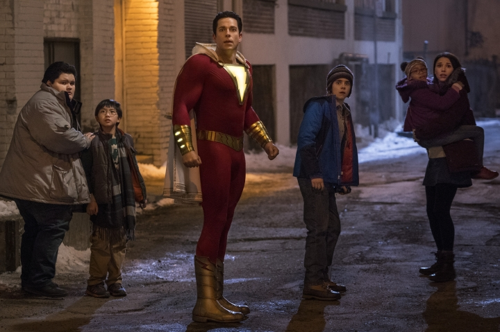 """This image released by Warner Bros. shows Zachary Levi, center, and Jack Dylan Grazer, center right, in a scene from """"Shazam!"""" (Steve Wilkie/Warner Bros. Entertainment via AP)"""