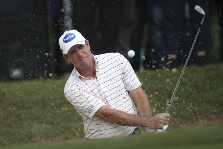 Scott Hend of Australia play his shot from a bunker on the 18th hole in a playoff on the way to winning the Malaysia Golf Championship in Kuala Lumpur, Malaysia, Sunday, March 24, 2019. (AP Photo/Vincent Phoon)