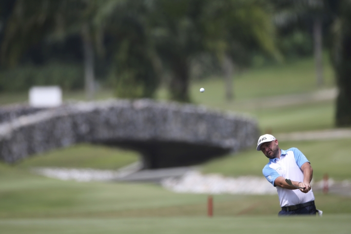 Andy Sullivan of England chips to the 6th green at the final round of the Malaysia Golf Championship in Kuala Lumpur, Malaysia, Sunday, March 24, 2019. (AP Photo/Vincent Phoon)