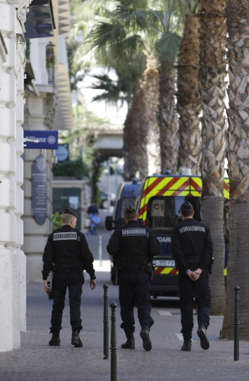 Police officers patrol in Beaulieu-sur-Mer, southern France, Sunday, March, 24, 2019, where French President Emmanuel Macron and Chinese President Chinese President Xi Jinping will meet. A police boat and police divers worked to secure the area before his arrival, and security cordons blocked several roads in Nice, where Xi will stay overnight. (AP Photo/Claude Paris)
